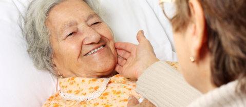elderly smiling to her caregiver